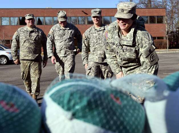 National Guard members arrive to collect their turkeys during the seventh annual Turkeys for Veterans on Tuesday, Nov. 24, 2015, at Tully Rinckey in Colonie, N.Y. From left are SPC Dan Tagliento, SSG Erich Schmidt, SGT Cody Rogers and SFC Stephanie Fiebke. Tully Rinckey and Hannaford Supermarkets handed out 200 turkeys to active duty and retired military personnel for their Thanksgiving Day dinners. (Cindy Schultz / Times Union) Photo: Cindy Schultz / 10034303A