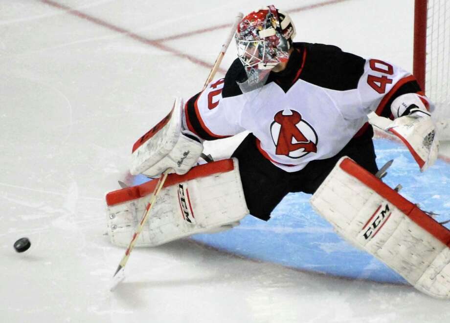 Albany Devils goalie Yann Danis stops a shot on goal by the Portland Pirates during Saturday's game at the Times Union Center Oct. 24, 2015 in Albany, NY.  (John Carl D'Annibale / Times Union) Photo: John Carl D'Annibale / 10033891A