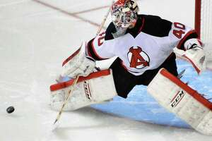 Well-traveled Devils goalie Yann Danis feeling at home in Albany - Photo