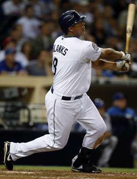 San Diego Padres' Kyle Blanks blasts a three-run home run in the ninth inning to give the Padres a 4-1 victory over the Chicago Cubs during a baseball game Monday, Aug. 17, 2009, in San Diego. (AP Photo/Lenny Ignelzi)
