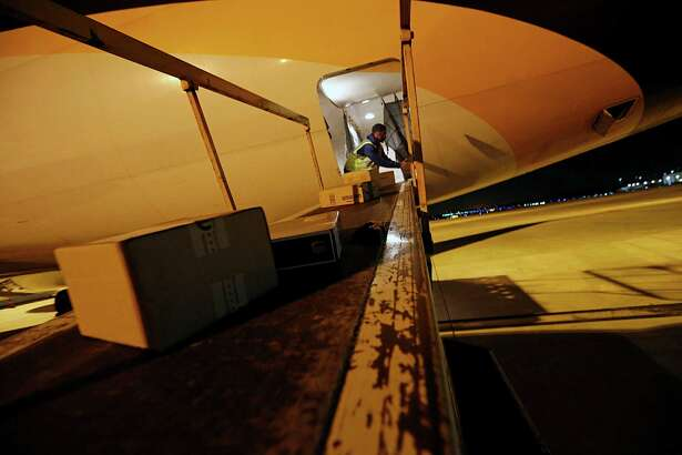 Air freight unloaded from a UPS Boeing 767 at the UPS Bush Intercontinental Airport air freight location Wednesday, Nov. 18, 2015, in Houston.  ( James Nielsen / Houston Chronicle )
