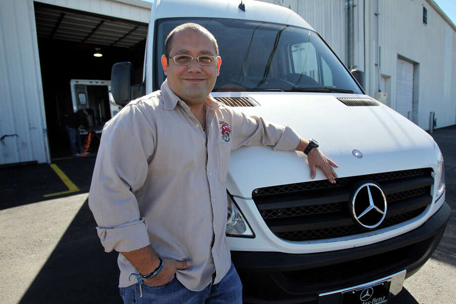 Kitchens on Wheels owner Felix Elorriaga stands by a Mercedes Sprinter in New Braunfels in 2010. Now, five customers who paid for food truck conversions are suing. Photo: Express-News File Photo / © 2010 San Antonio Express-News