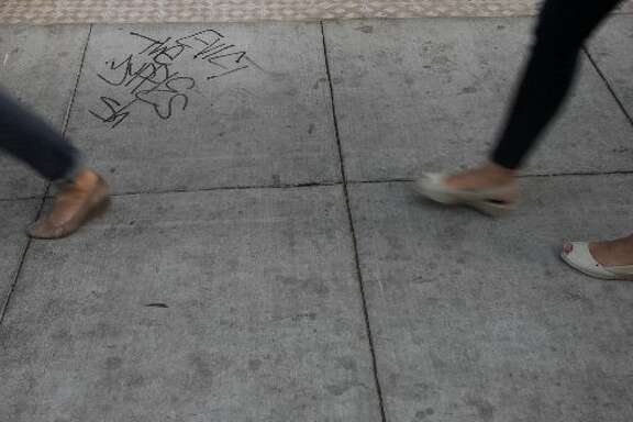 """Evict the yuppies"" graffiti."