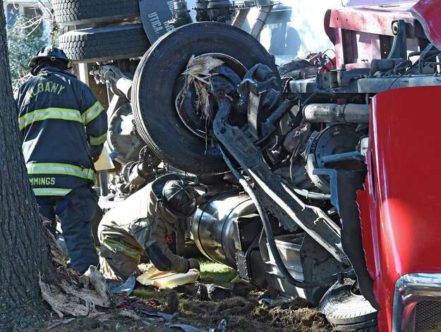 Albany firefighters try to stop the flow of fuel after a heating fuel truck rolled over on Melrose St  Tuesday morning Nov. 24, 2015 in Albany, N.Y. (Skip Dickstein/Times Union) Photo: SKIP DICKSTEIN