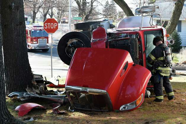 A heating fuel truck sits heavily damaged after it rolled over on Melrose St  Tuesday morning Nov. 24, 2015 in Albany, N.Y. (Skip Dickstein/Times Union) Photo: SKIP DICKSTEIN