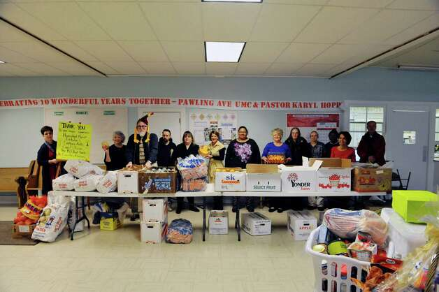 Staff and volunteers prepare at the Hope 7 Food Pantry on Tuesday, Nov. 24, 2015, in Troy, N.Y. for their Thanksgiving food basket event.  (Paul Buckowski / Times Union) Photo: PAUL BUCKOWSKI / 10034350A