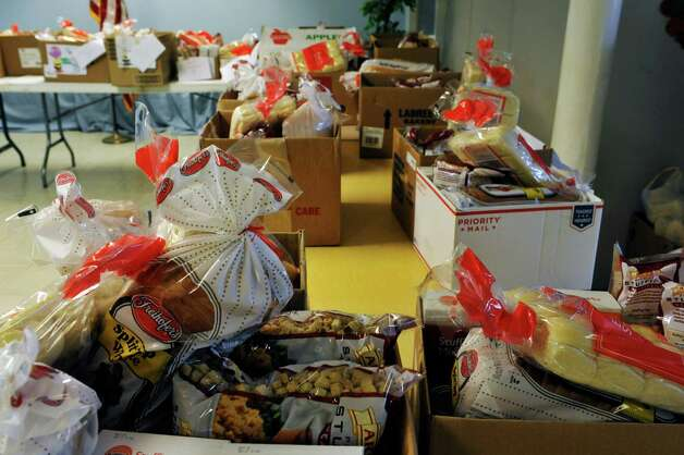 Food baskets are seen lined up on tables at the Hope 7 Food Pantry on Tuesday, Nov. 24, 2015, in Troy, N.Y.   (Paul Buckowski / Times Union) Photo: PAUL BUCKOWSKI / 10034350A