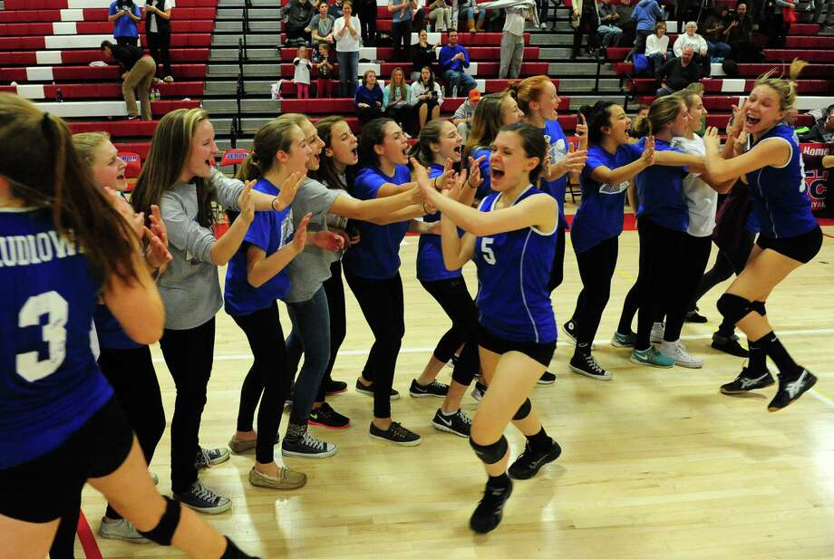 Ludlowe celebrates its Class LL volleyball title over Greenwich last Saturday at Berlin High School. The Falcons won in straight sets for its first-ever state championship. Photo: Christian Abraham / Hearst Connecticut Media / Connecticut Post
