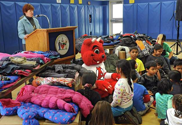 Mayor Kathy Sheehan speaks at a an event announcing over 1400 new coats, hats, gloves and scarves purchased with donations from the 2015 Cash for Coats program will help keep Albany kids warm this winter at Delaware Community School on Tuesday, Nov. 24, 2015 in Albany, N.Y. (Lori Van Buren / Times Union) Photo: Lori Van Buren / 10034386A