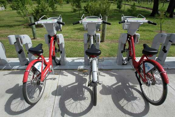 A B-Cycle location near the Houston Zoo at Hermann Park Lake Plaza, 6100 Hermann Park Drive, is shown Friday, July 11, 2014, in Houston. The zoo location is the city's most popular spot for picking up the recognizable bikes. ( Melissa Phillip / Houston Chronicle )