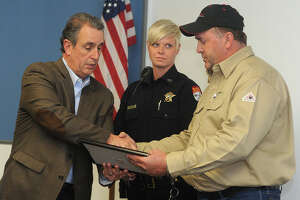 Southeast Texas rescuers honored for saving driver in burning van - Photo