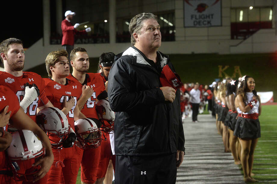 Lamar University's head coach Ray Woodard joins the team and others in observing the National Anthem before facing Nicholls State during Saturday's homecoming game at Provost Umphrey Stadium. Photo taken Saturday, November 7, 2015 Kim Brent/The Enterprise Photo: Kim Brent / Beaumont Enterprise
