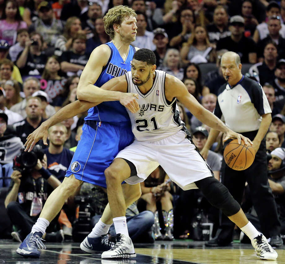 San Antonio Spurs' Tim Duncan looks for room around Dallas Mavericks' Dirk Nowitzki during first half action of Game 7 in the first  round of the Western Conference playoffs  Sunday May 4, 2014 at the AT&T Center. Photo: Edward A. Ornelas, Staff / San Antonio Express-News / © 2014 San Antonio Express-News
