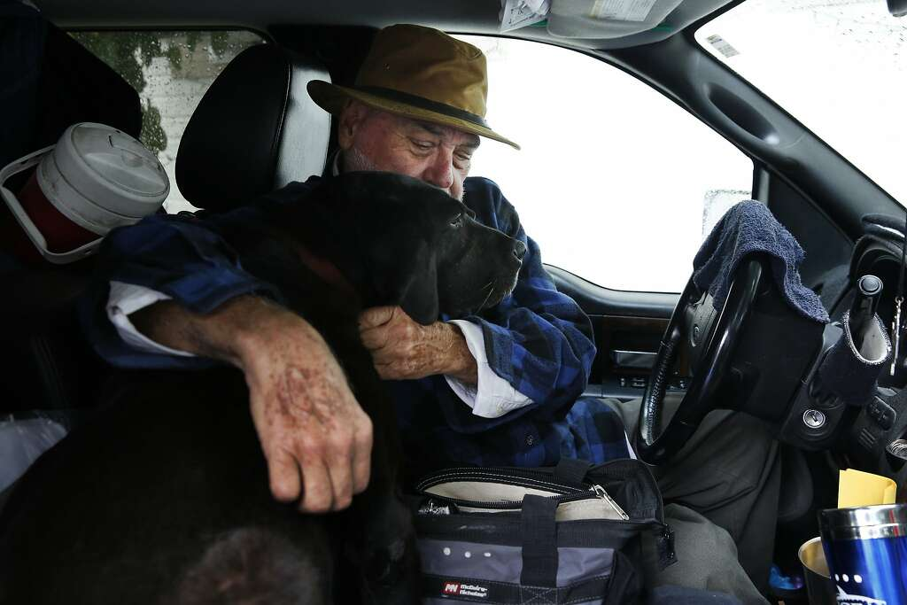 Fred Cope III Sits In His Truck With Midnight Favorite Dog Outside Of