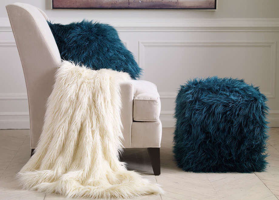 Faux fur throws and ottomans are part of Ethan Allen's effort to appeal to younger clientele. Photo: Contributed Photo / Contributed Photo / Connecticut Post Contributed