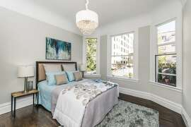 Bay windows provide the master suite neighborhood views and substantial natural light.