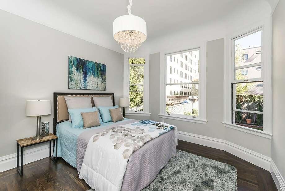 Bay windows provide the master suite neighborhood views and substantial natural light. Photo: Olga Soboleva/Vanguard Propertie