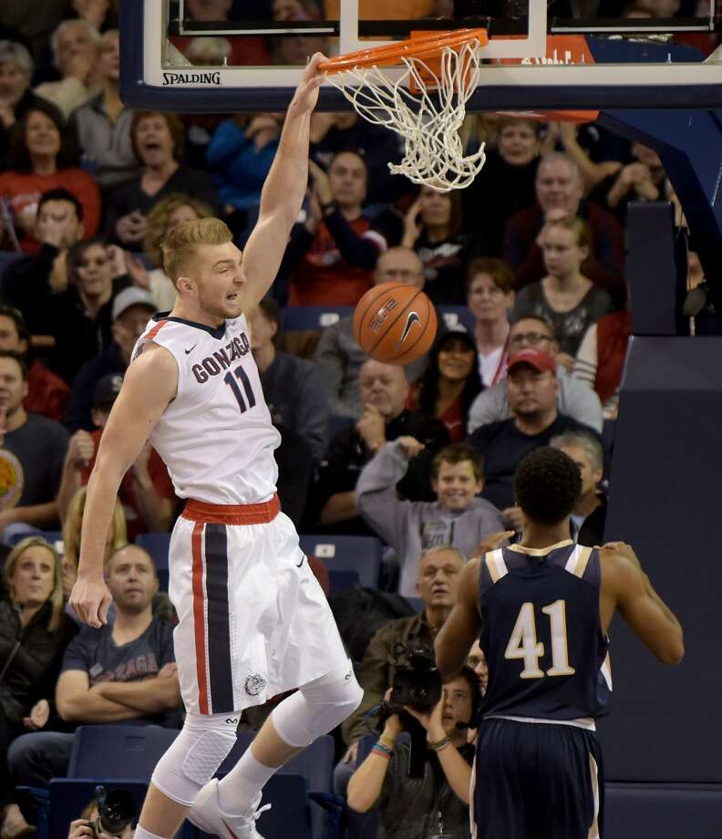 FILE - In this Nov. 21, 2015, file photo, Gonzaga's Domantas Sabonis (11) dunks over Mount St. Mary's BK Ashe (41) in the first half of an NCAA college basketball game, in Spokane, Wash. This year's Battle 4 Atlantis tournament bracket is anchored by three Top 25 teams led by No. 10 Gonzaga, along with No. 19 Connecticut and new addition Texas A&M at No. 25. (AP Photo/Rajah Bose, File) Photo: Rajah Bose, Associated Press