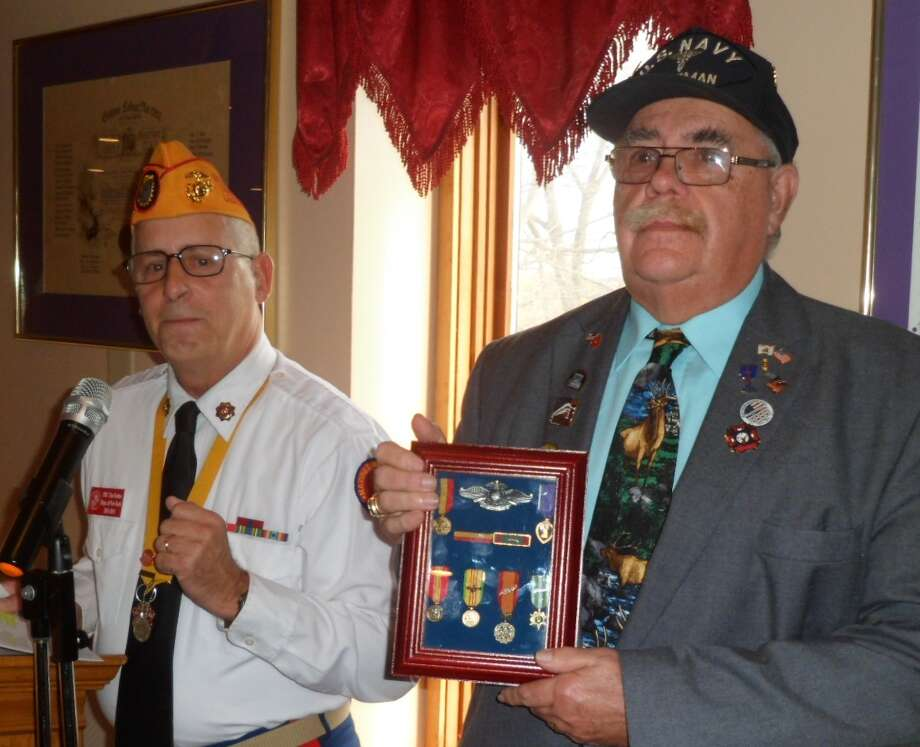Lodge member Roland C. Abare was honored at the Cohoes-Waterford Elks #1317 annual Veterans Day Luncheon/Flag Retirement Ceremony on Saturday, Nov. 7. Marine Corps League – Northeast Division Assistant Vice Commandant Timothy Forbes presented Abare with medals and ribbons he earned in Vietnam, including the Purple Heart. (Regina M. Hogan) / COPYRIGHT, 2011