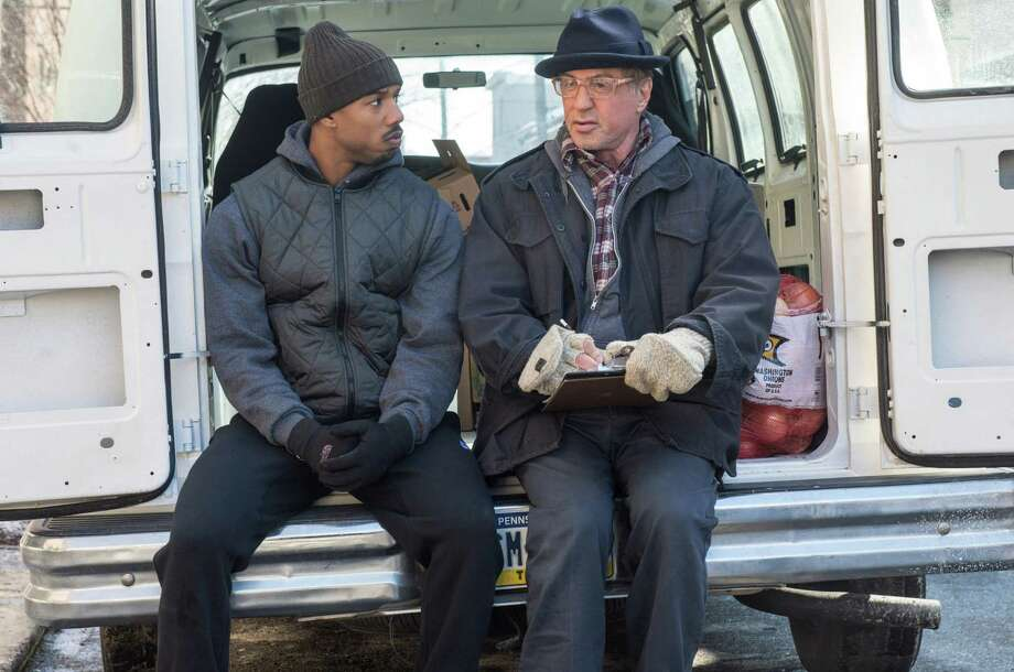 """This photo provided by Warner Bros. Pictures shows Michael B. Jordan, left, as Adonis Johnson and Sylvester Stallone as Rocky Balboa in Metro-Goldwyn-Mayer Pictures', Warner Bros. Pictures' and New Line Cinema's drama """"Creed,"""" a Warner Bros. Pictures release. (Barry Wetcher/Warner Bros. Pictures via AP) ORG XMIT: CAET187 Photo: Barry Wetcher / Warner Bros. Pictures"""