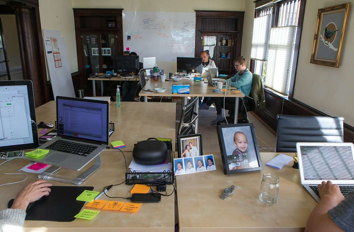 Robert Zimmerman (left) and Annie Pennell work in the open office space with founders, Ben Lee and Niles Lichtenstein on Friday, Nov. 20, 2015 in Oakland, Calif.