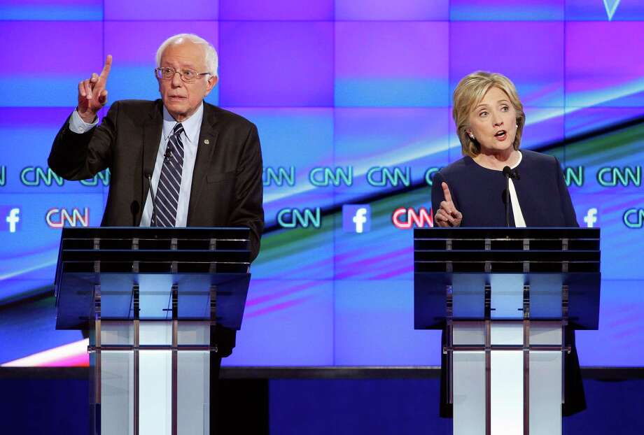 Democratic presidential candidate, Hillary Rodham Clinton, right, and Sen. Bernie Sanders, I-Vt., speak during the Democratic presidential debate in Las Vegas. Photo: John Locher / Associated Press / AP