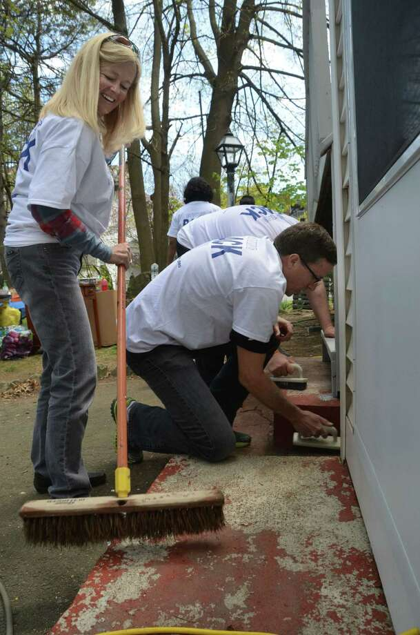 Sandy Nyenhuis and AmeriCares CEO Michael Nyenhuis pitch in on May 2, 2015 around the home of Ann Marie Jameís in Stamford, Conn. where AmeriCares is based, as part of the annual HomeFront volunteer day. Photo: Contributed, Contributed Photo / Stamford Advocate contributed