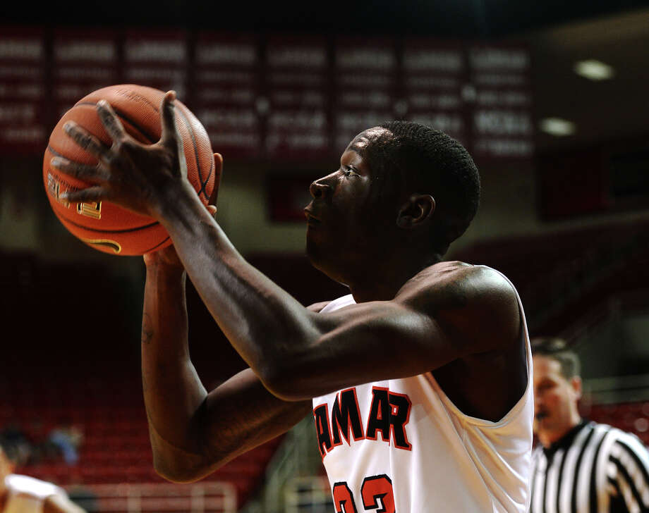 Lamar's Dontavious Sears, No. 23, lines up a shot on the basket during Tuesday's game against Huston-Tillotson. The Lamar Cardinals hosted the Huston-Tillotson Rams at the Montagne Center on Tuesday night. Photo taken Tuesday 12/30/14 Jake Daniels/The Enterprise Photo: Jake Daniels / ©2014 The Beaumont Enterprise/Jake Daniels