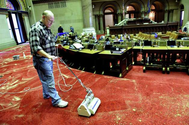 John Buell of Buell's Floor Covering in East Greenbush cleans the wool carpet in the Assembly Chamber on Tuesday, Nov. 24, 2015, at the Capitol in Albany, N.Y. It takes three workers three days to clean the nearly 10,000-square foot carpet. (Cindy Schultz / Times Union) Photo: Cindy Schultz / 10034413A