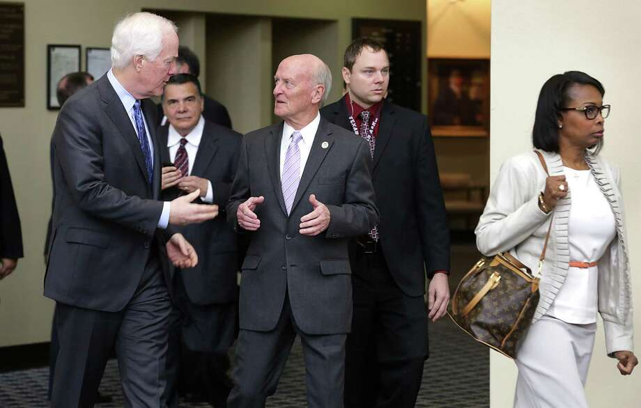 Sen. John Cornyn (left) talks with Judge Fred Biery during a tour of the John H. Wood Federal Courthouse. The group also included Mayor Ivy Taylor (right) and other officials. Photo: Bob Owen /San Antonio Express-News / San Antonio Express-News