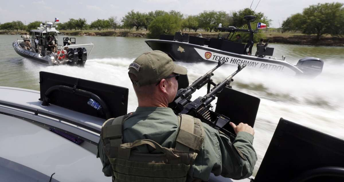 FILE - In this July 24, 2014 file photo, Texas Department of Safety Troopers patrol on the Rio Grand along the U.S.-Mexico border, in Mission, Texas. The state?'s new Republican governor, Greg Abbott, this month approved $800 million for border security over the next two years, more than double any similar period under 14 years of Perry, and by comparison, more than the state spends on environmental regulation. (AP Photo/Eric Gay, Pool, File)