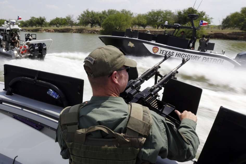 FILE - In this July 24, 2014 file photo, Texas Department of Safety Troopers patrol on the Rio Grand along the U.S.-Mexico border, in Mission, Texas. The state's new Republican governor, Greg Abbott, this month approved $800 million for border security over the next two years,  more than double any similar period under 14 years of Perry, and by comparison, more than the state spends on environmental regulation. (AP Photo/Eric Gay, Pool, File)