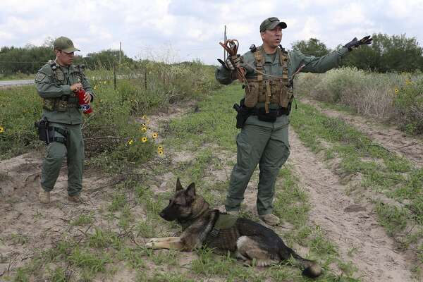 "U.S. Border Patrol Search, Trauma and Rescue (BORSTAR) Agents Jesus Robles, left, and Isaac David arrive to help in the search for a group of over 10 immigrants on a ranch near Falfurrias, Texas, Tuesday, Sept. 22, 2015. With David is his dog, ""Igor,"" a three-year-old German Shepherd trained to sniff the scent of humans. BORSTAR has seen rescues of immigrants in the Rio Grande Valley sector of Border Patrol surge in FY 2015 compared to a year before."