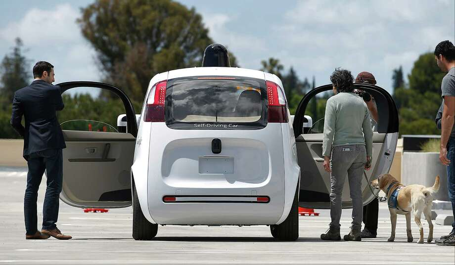 FILE - In this  May 13, 2015, file photo, riders enter the Google's new self-driving prototype car for a ride during a demonstration at Google campus, in Mountain View, Calif. Federal transportation officials say they are updating their position on self-driving cars, with a goal of getting the emerging technology into the public's hands sooner than later. (AP Photo/Tony Avelar, File) ORG XMIT: LA302 Photo: Tony Avelar / FR155217 AP