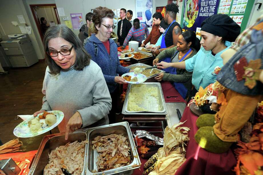 Students at the Alternative Center for Excellence along with Abbott Technical High School host an annual Thanksgiving dinner for the community at the Alternative Center Tuesday, Nov. 24, 2015. Photo: Carol Kaliff / Hearst Connecticut Media / The News-Times