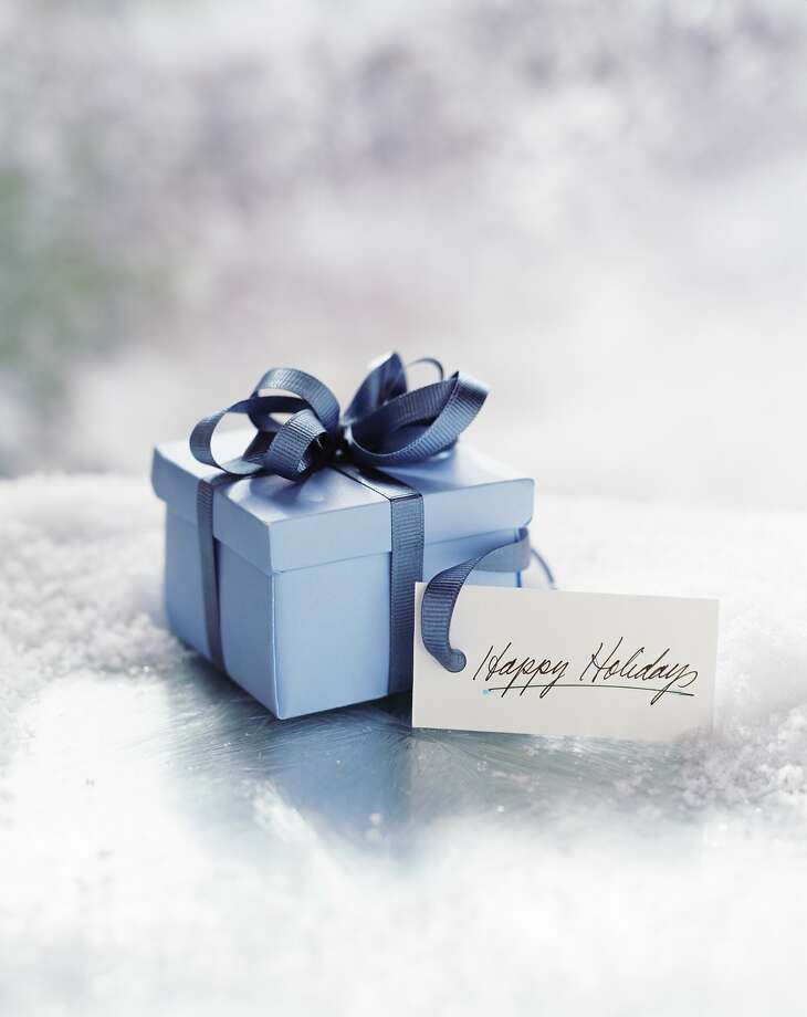 Perfect gifts for your favorite travelers Blue gift with note Photo: Getty Images