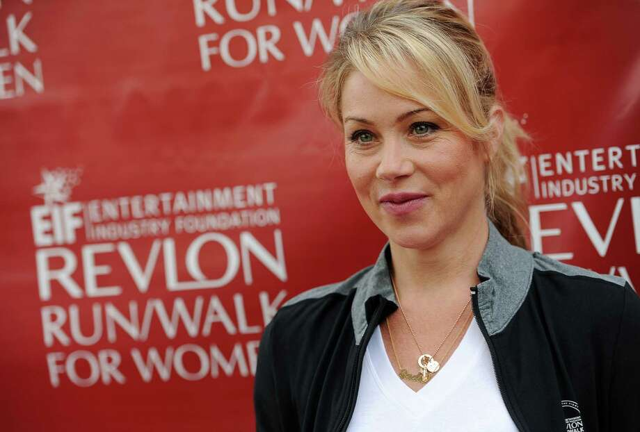 Actress Christina Applegate poses at the 21st Annual EIF Revlon Run/Walk for Women on Saturday, May 10, 2014 in Los Angeles. (Photo by Chris Pizzello/Invision/AP) ORG XMIT: CACP115 Photo: Chris Pizzello / Invision