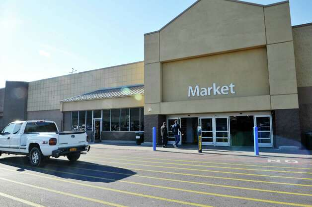 A view of the bottle return area, glass windows on the left in photo, next to the entrance at the Walmart Supercenter off of Route 4 on Tuesday, Nov. 24, 2015, in Rensselaer, N.Y. (Paul Buckowski / Times Union) Photo: PAUL BUCKOWSKI / 10034422A