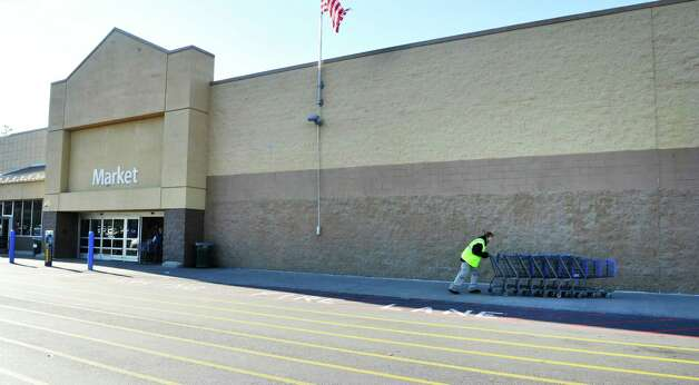 A Walmart employee pushes a line of shopping carts at the Walmart Supercenter off of Route 4 on Tuesday, Nov. 24, 2015, in Rensselaer, N.Y. (Paul Buckowski / Times Union) Photo: PAUL BUCKOWSKI / 10034422A