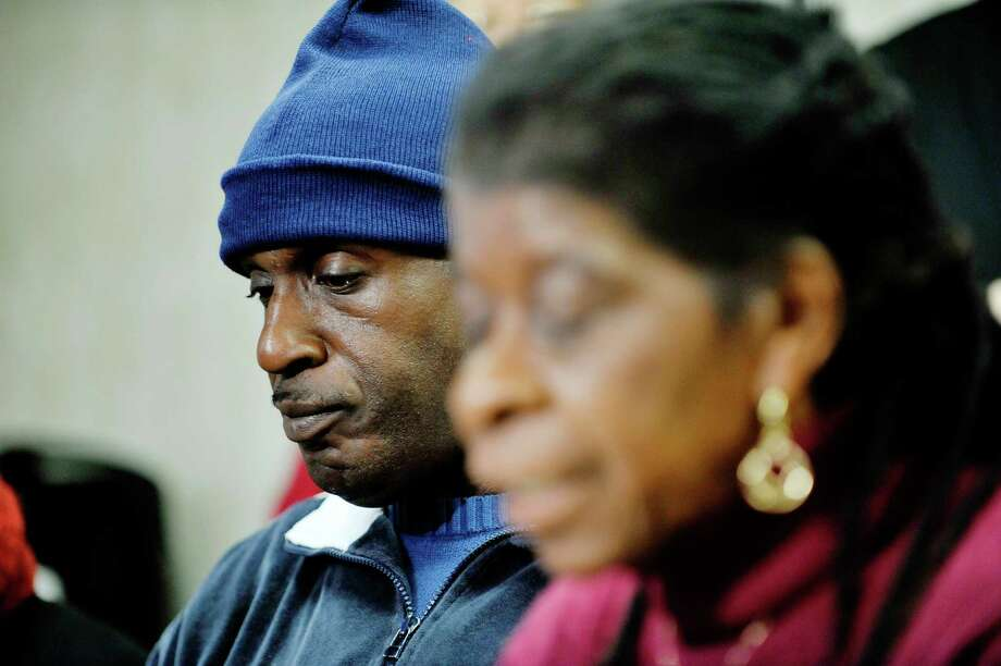 Fired Wal-Mart employee, Thomas Smith, left, listens as Alice Green, right, director of the Center for Law & Justice, talks about Smith being firing from his job at a press conference at the Center for Law & Justice on Tuesday, Nov. 24, 2015, in Albany, N.Y.  Those attending the press conference are calling on Walmart to issue an apology and to reinstate Thomas Smith as an employee at anther Walmart location in the area. (Paul Buckowski / Times Union) Photo: PAUL BUCKOWSKI / 10034416A