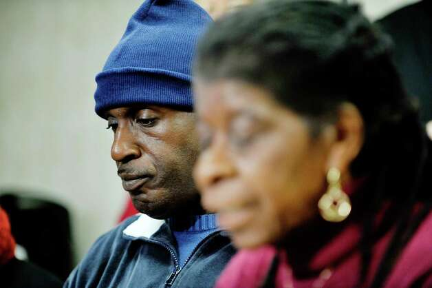 Fired Walmart employee, Thomas Smith, left, listens as Alice Green, right, director of the Center for Law & Justice, talks about Smith being firing from his job at a press conference at the Center for Law & Justice on Tuesday, Nov. 24, 2015, in Albany, N.Y.  Those attending the press conference are calling on Walmart to issue an apology and to reinstate Thomas Smith as an employee at anther Walmart location in the area. (Paul Buckowski / Times Union) Photo: PAUL BUCKOWSKI / 10034416A
