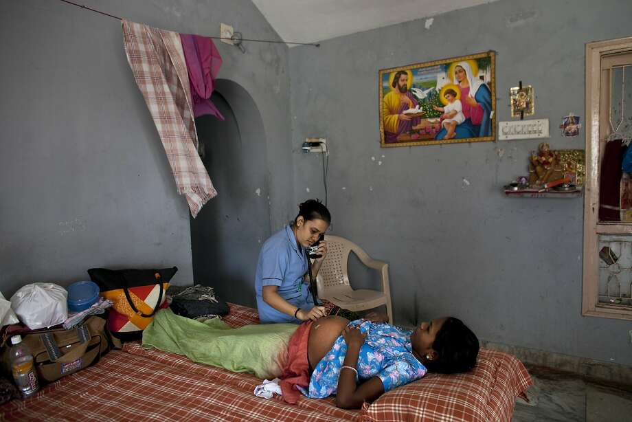 A nurse helps a surrogate mother in Anand, India. The government has banned surrogate services for foreigners and ordered clinics to stop hiring Indian women to bear children. Photo: Allison Joyce, Associated Press