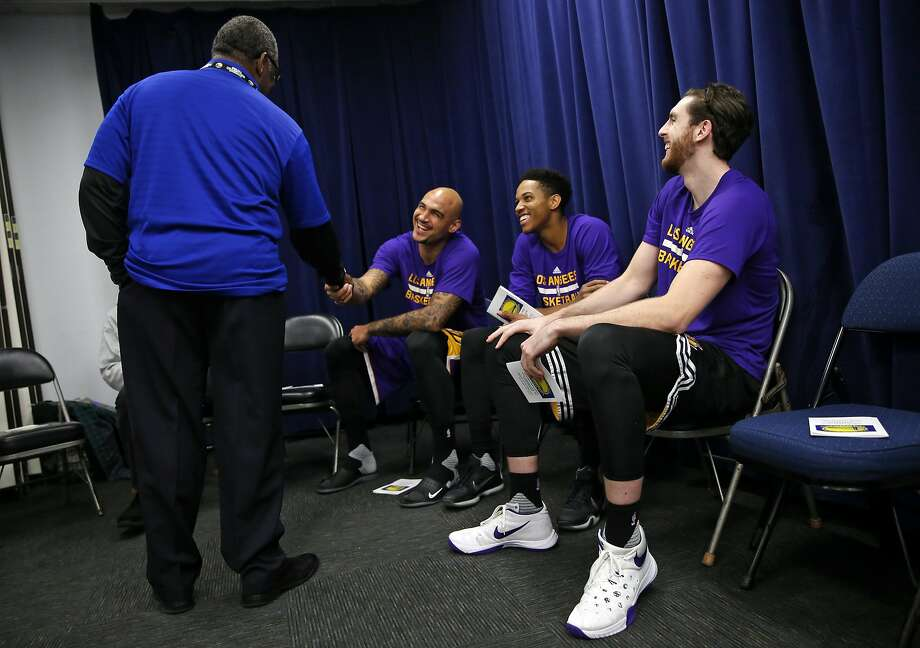 Golden State Warriors' chaplain Earl Smith greets Los Angeles Lakers' Robert Sacre before chapel service before NBA game at Oracle Arena in Oakland, Calif., on Tuesday, November 24, 2015. Photo: Scott Strazzante, The Chronicle