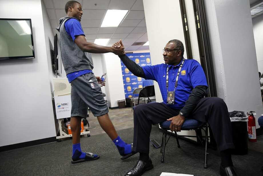 Golden State Warriors' chaplain Earl Smith greets Harrison Barnes before chapel service before NBA game at Oracle Arena. Photo: Scott Strazzante, The Chronicle