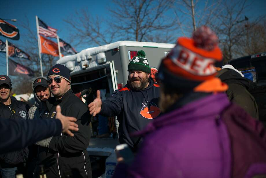 John McKendrick greets other Chicago Bears fans tailgating in the parking lot south of Soldier Field before a game. The parking lot is where the Lucas Museum of Narrative Art is proposed to be built. Photo: Rob Hart, Special To The Chronicle