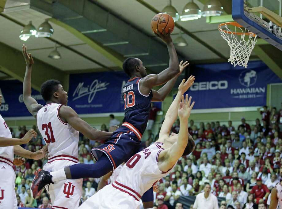 St. John's guard Felix Balamou (10) goes to the basket as Indiana's Thomas Bryant (31) and Collin Hartman, right, defend in the first half during an NCAA college basketball game in the second round of the Maui Invitational Tuesday, Nov. 24, 2015, in Lahaina, Hawaii.  (AP Photo/Rick Bowmer)   ORG XMIT: HIRB104 Photo: Rick Bowmer / AP