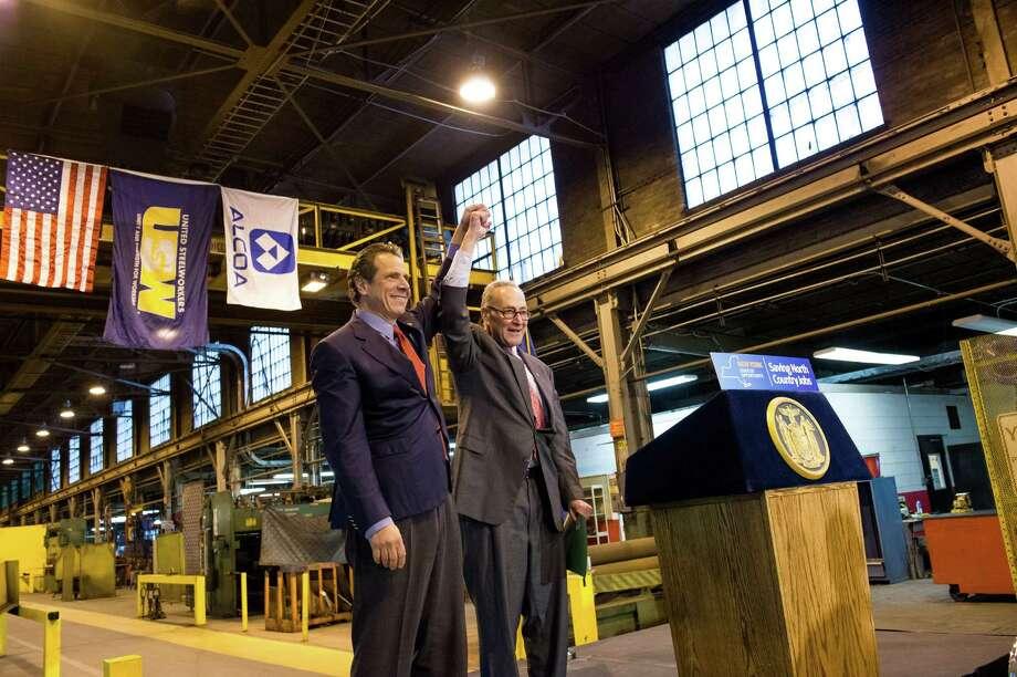 Gov. Andrew Cuomo and Senator Chuck Schumer announce a deal to preserve jobs at the Alcoa facility in Massena, N.Y., Tuesday, Nov. 24, 2015. (Darren McGee/Office of the Governor) Photo: Office Of The Governor)