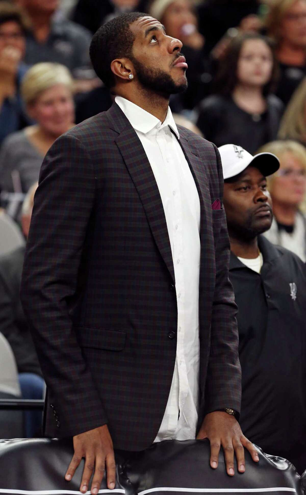 San Antonio Spurs' LaMarcus Aldridge stands during a timeout while on the bench during first half action against the Phoenix Suns Monday Nov. 23, 2015 at the AT&T Center.