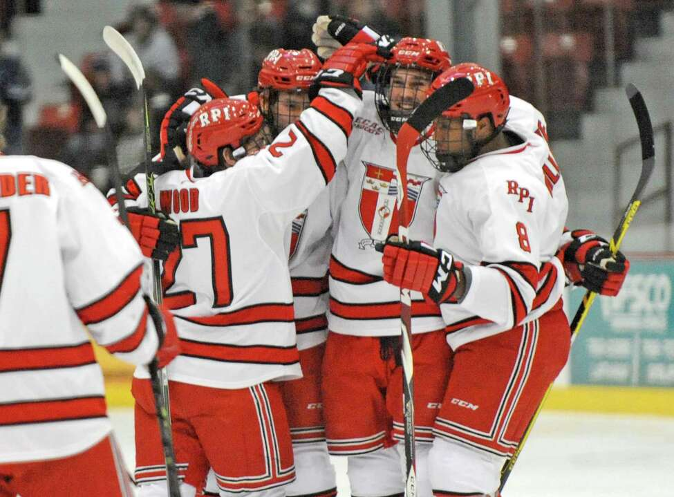 RPI's Mike Prapavessis , center, is congratulated by teammates after scoring a goal during their men's college hockey game against New Hampshire at the Houston Field House on Tuesday Nov. 24, 2015 in Troy, N.Y. (Michael P. Farrell/Times Union)