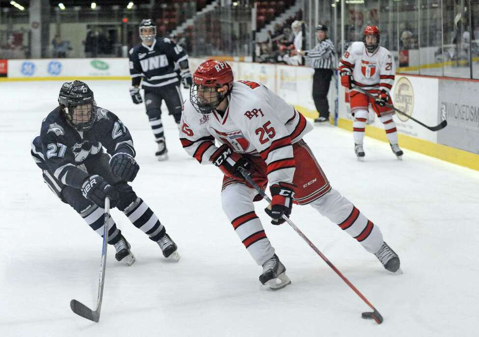 RPI's Mark Miller looks to pass during their men's college hockey game against New Hampshire at the Houston Field House on Tuesday Nov. 24, 2015 in Troy, N.Y. (Michael P. Farrell/Times Union)